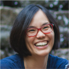 Photo of Wendy Fu, a woman in red glasses smiling at the camera.