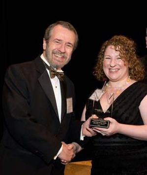 Heather Rocker (right) receives Outstanding Young Engineering Alumni Award from Dean Giddens