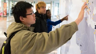 international education front page - students with map